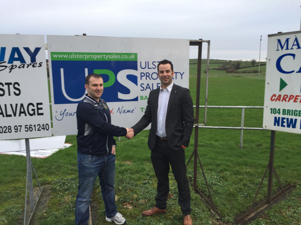 Aaron Ferris of Ulster Property Sales presenting Ballynahinch United Treasurer Gareth Bingham with a sponsorship cheque
